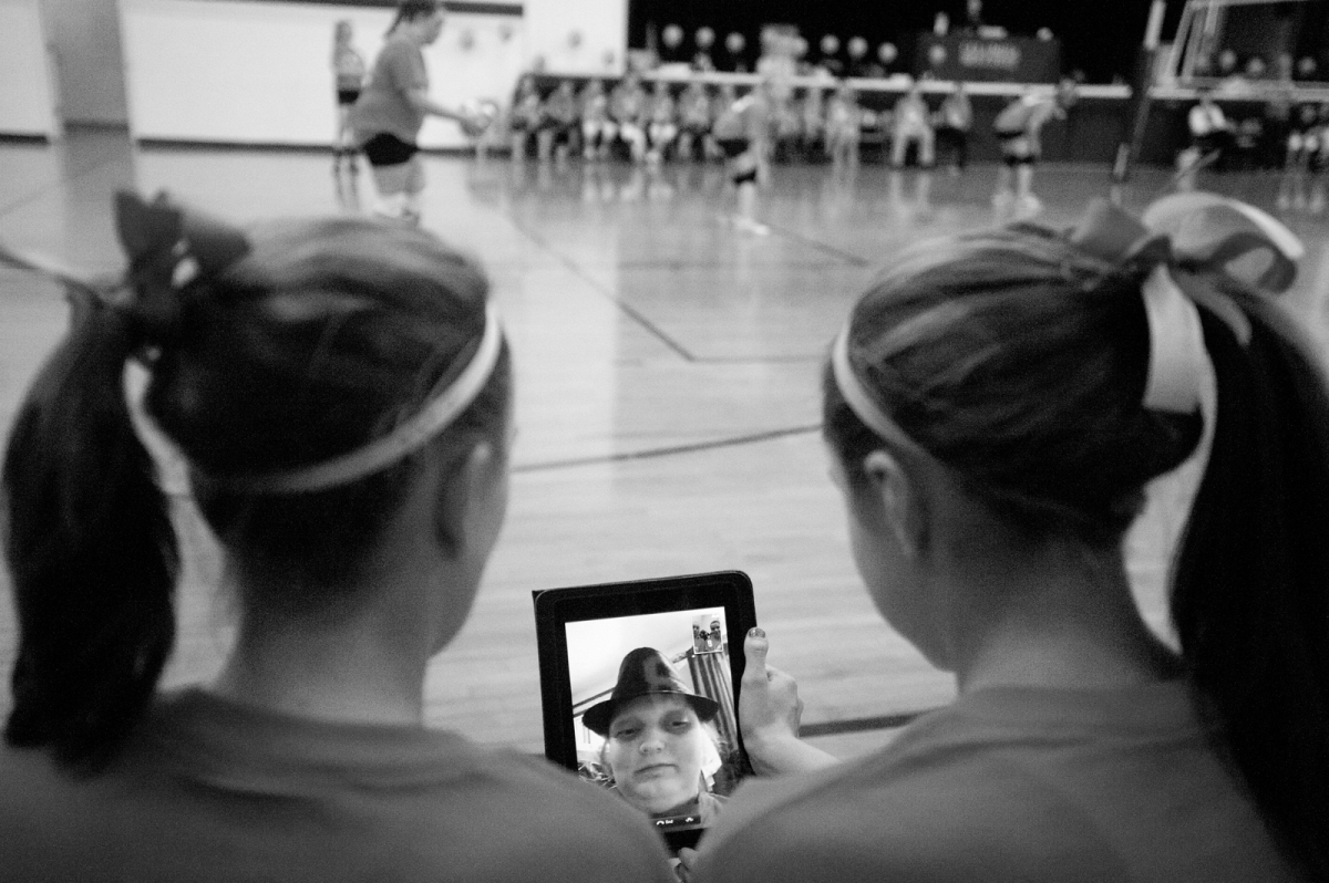 Allie video chats with friends and watches the volleyball game during the Volley for Hope event at Columbia Middle School to raise money for the DeBaeke family. The Volley for Hope and other fundraisers have raised about $2,000 for Allie and her family.
