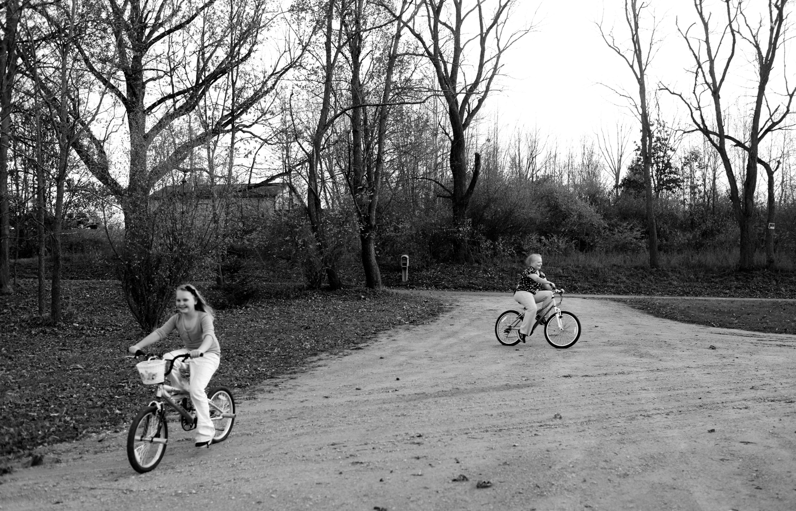 Allie and her cousin Morgan ride their bikes in front of their grandmother's home in Jackson County, Mich. on Thursday, October 25, 2012. Allie doesn't get to see her friends very much, but gets to play with her cousins when they visit.