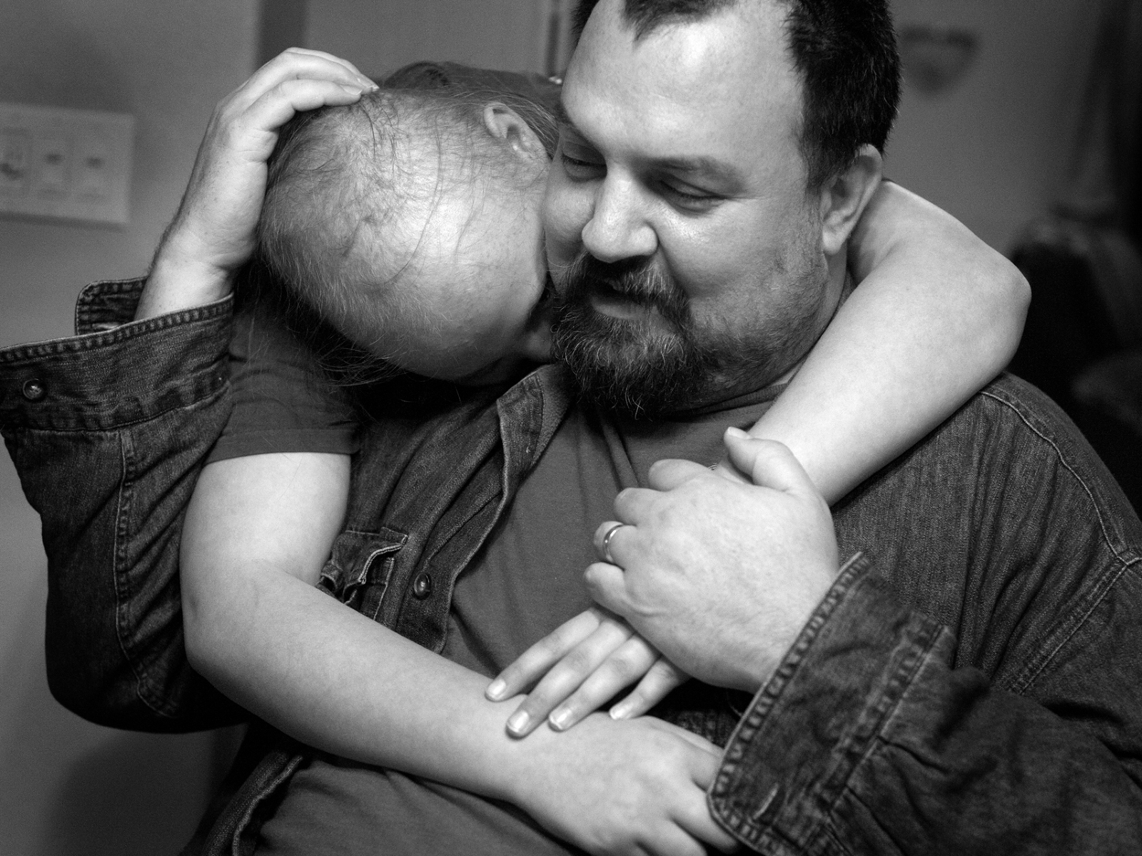 Allie DeBake, 13, and her dad, Scott DeBake, embrace in Scott's mother's home in Jackson County, Mich. on Tuesday, November 13, 2012.