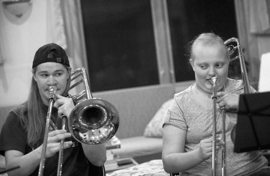 Jared Jarvis, 17, plays Jingle Bell Rock with Allie on trombones on Thursday, December 6, 2012. Jarvis is in the marching band and jazz band at Columbia Central and comes over every once in a while to help Allie keep up with trombone lessons.
