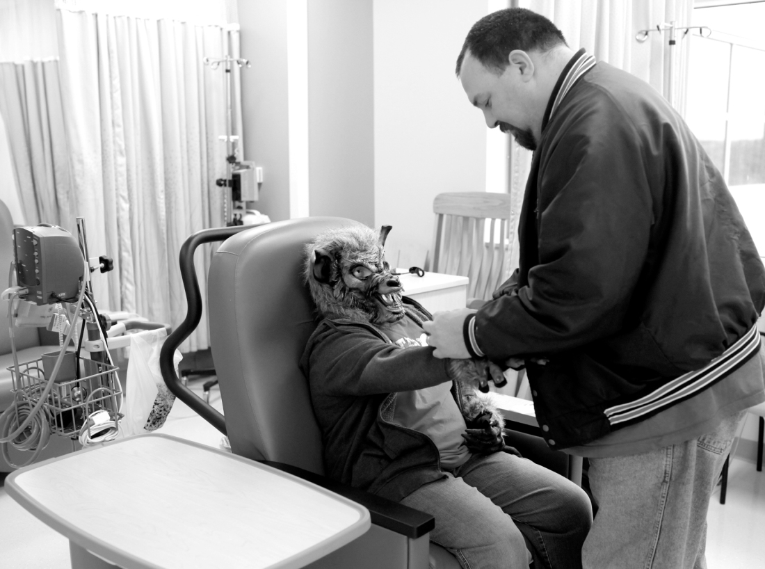 Scott DeBaeke helps his daughter with her werewolf gloves while they wait for a nurse to administer her infusion at Motts Children's Hospital at the University of Michigan Hospital in Ann Arbor, Mich. on Monday, October 29, 2012.